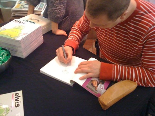 Tony signing my book